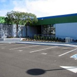 Parking lot and accessible building entrance, including electric car charging station